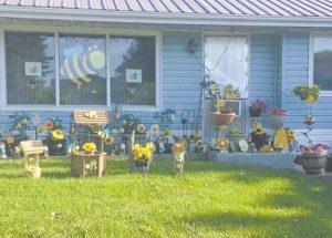 PIC – Home owner shows her  Honey Festival spirit