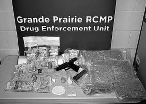 Grande Prairie RCMP charge males following search warrant execution