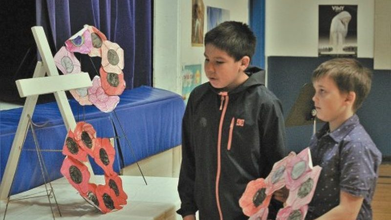 Ecole Providence students commemorate family members and locals who served