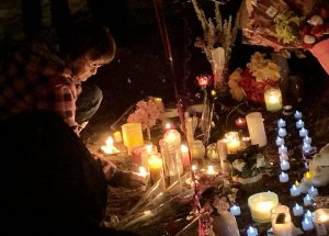 Tears flow at candlelight vigil