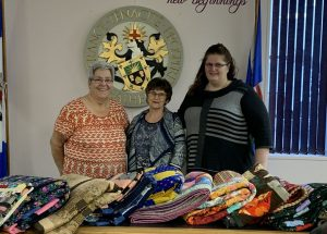 Vouchers, quilts bring warm Christmas cheer